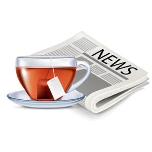newspaper and cup of tea isolated